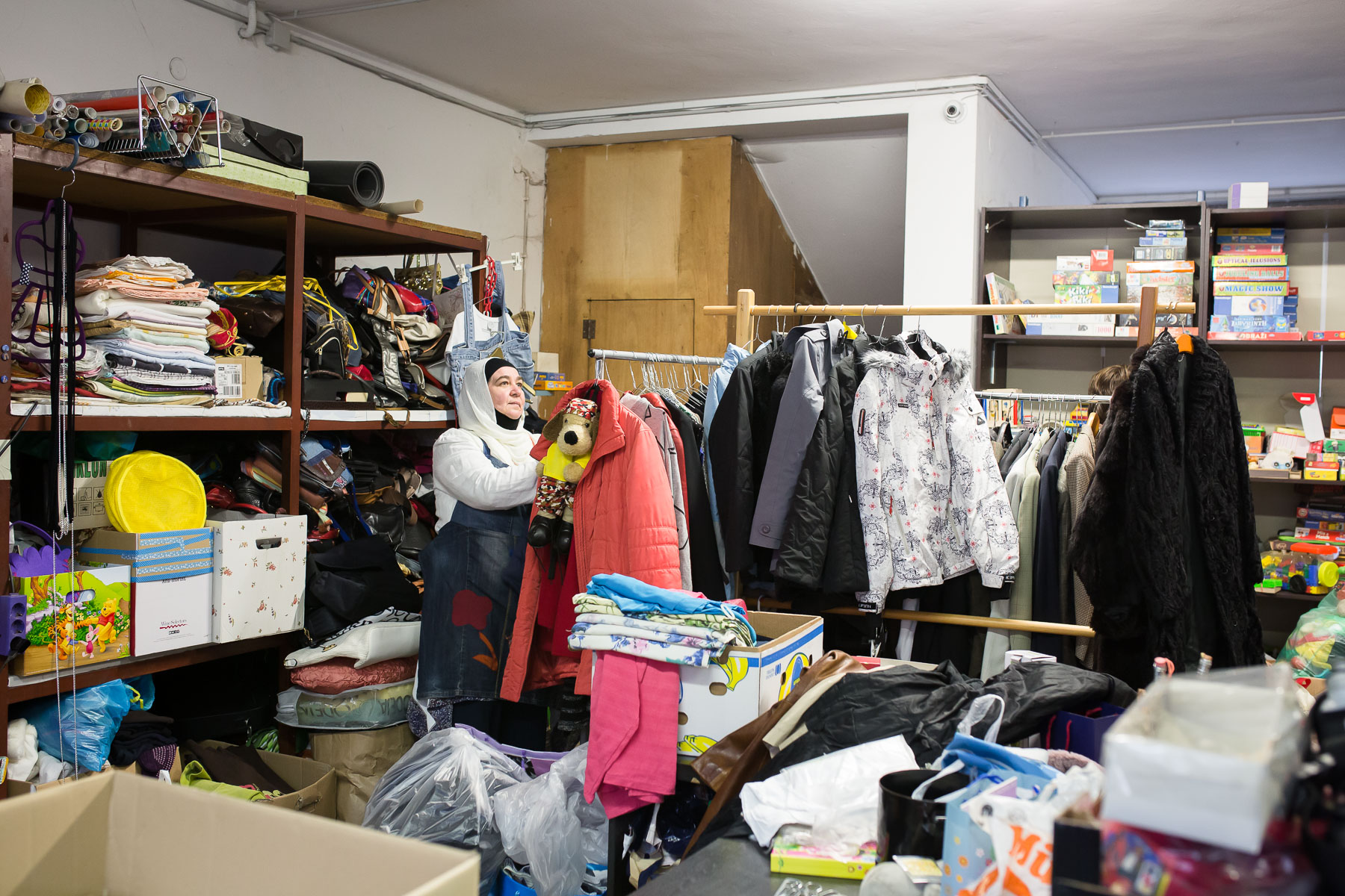 Senada inspects and stores discarded useable items in the storage of the Reuse center on May 8, 2019..