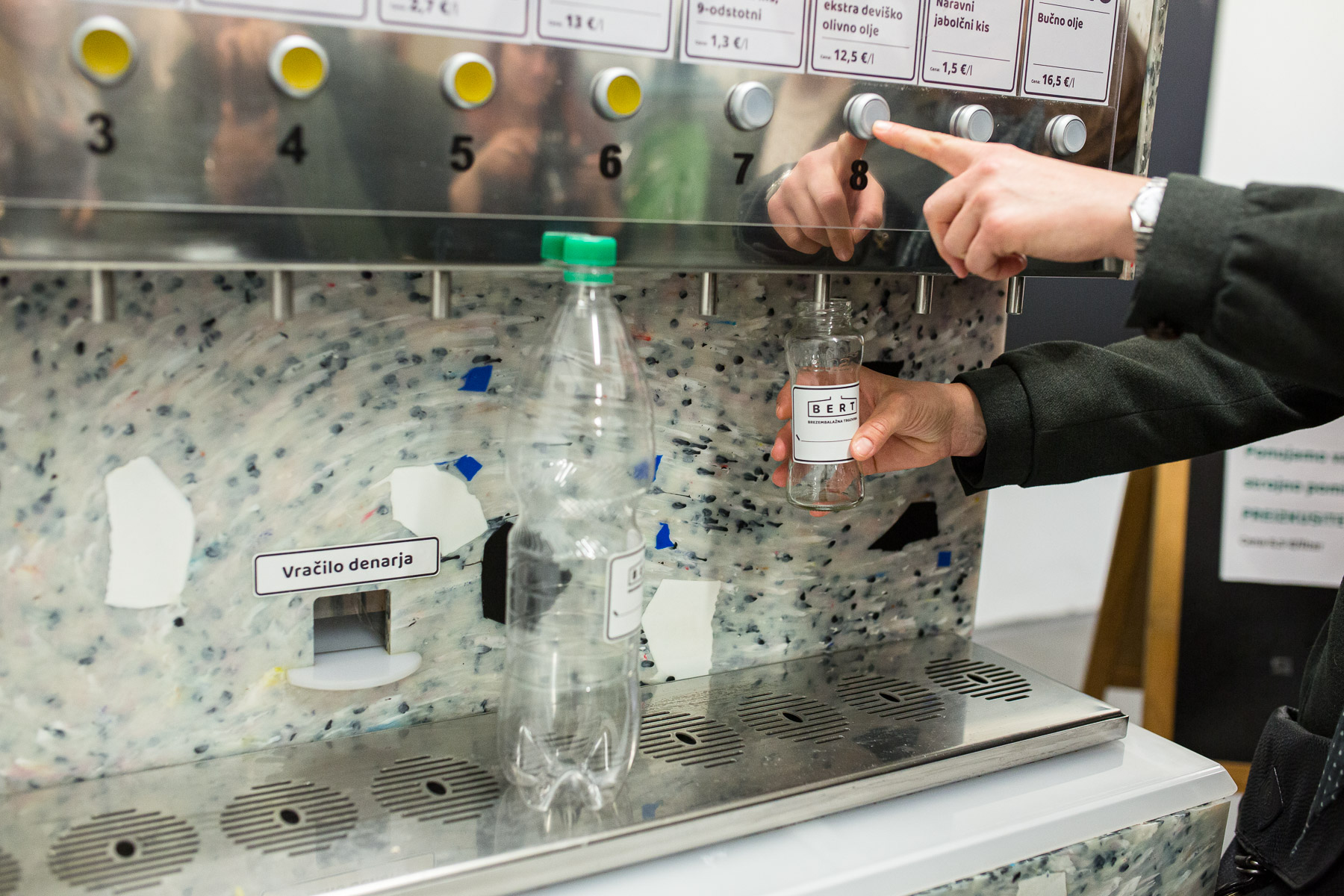 A customer uses one of two packaging-free vending machines called BERT  that offers 18 liquid products in Ljubljana, May 8, 2019.