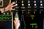 A customer uses one of two packaging-free vending machines called BERT  that offers 18 liquid products in Ljubljana, May 8, 2019. Using your own bottle or the one provided by BERT customers can buy shampoos, detergents,  juices, several types of vinegar and oil.