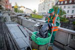 Voka Snaga workers regularly clean the streets of the historical city center of Ljubljana.