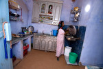 A Nubian woman washes the dishes in her kitchen in a Nubian village near Aswan.