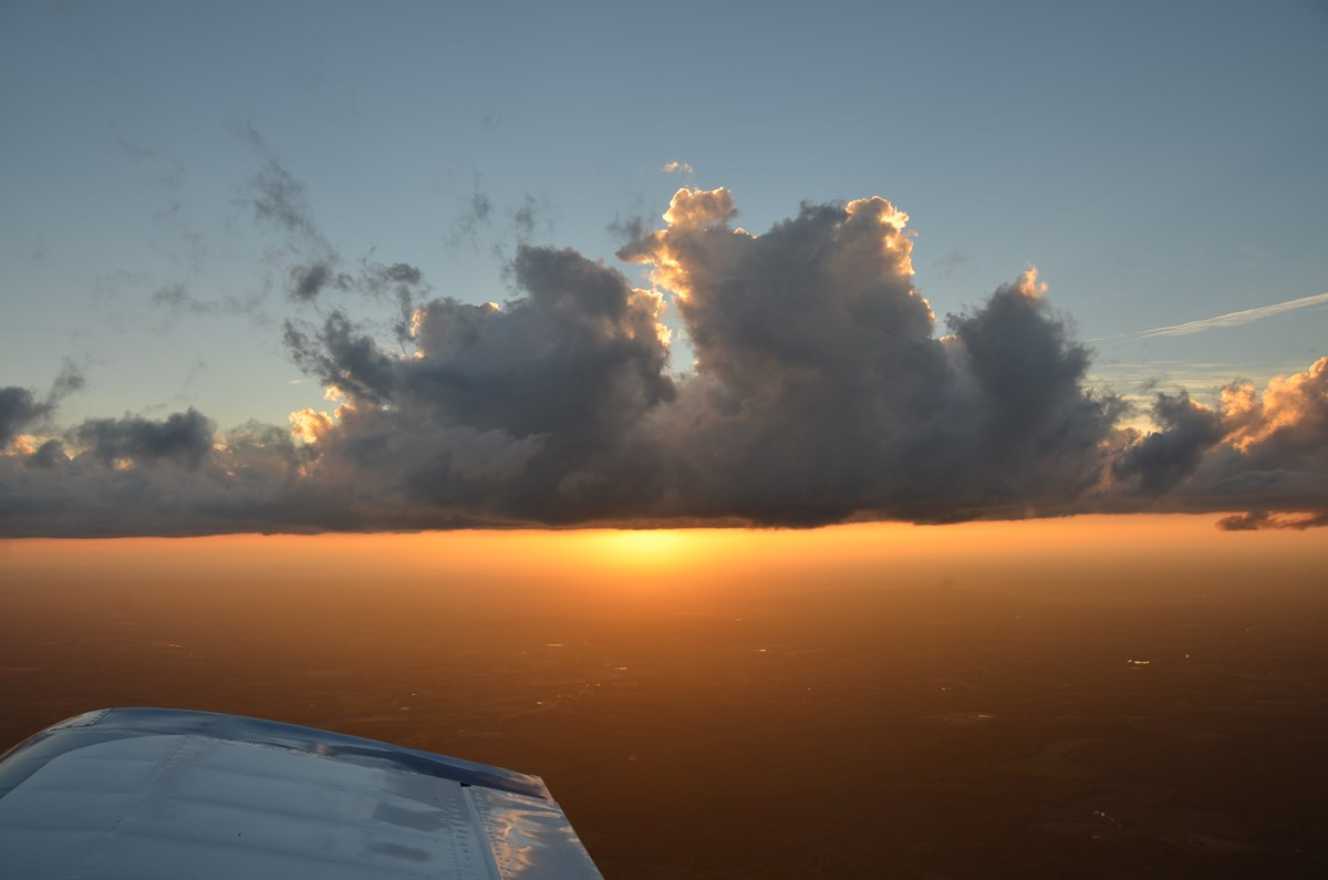 Having a plane AND a runway at your finger-tips is a luxury, but it allows you to act when the sky is about to give you one of those natural spectular vistas: October sunset 2013.