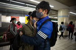 TAIPEI - MARCH 18:  A young couple embrace while waiting for a metro train in downtownTaipei, Taiwan on March 18, 2020. Taiwan, Singapore and Hong Kong have had more successful approaches in battling the pandemic given their experience with SARS in 2003. According to CDC current totals the Coronavirus ( COVID-19) has now effected 235,939 globally, killing 9,874. It has spread to 157 countries. (Photo by Paula Bronstein/Getty Images )BANGKOK - MARCH  :  in Taipei, Taiwan on March 19, 2020. According to CDC current totals the Coronavirus ( COVID-19) has now effected 235,939 globally, killing 9,874. It has spread to 157 countries. (Photo by Paula Bronstein/Getty Images )BANGKOK - MARCH  :  in Taipei, Taiwan on March 19, 2020. According to CDC current totals the Coronavirus ( COVID-19) has now effected 235,939 globally, killing 9,874. It has spread to 157 countries. (Photo by Paula Bronstein/Getty Images )