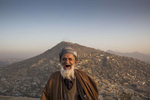 Eid Muhammad, 70 stands on the balcony overlooking the hills of Kabul.  Millions of Afghans live in informal settlements occupied without a formal deed, on land with unclear legal ownership. This lack of a functioning land management system, Afghan and international experts say, looms as one of the most serious obstacles to the country's economic development.Nov.21, 2014 Paula Bronstein/ The Wall Street Journal