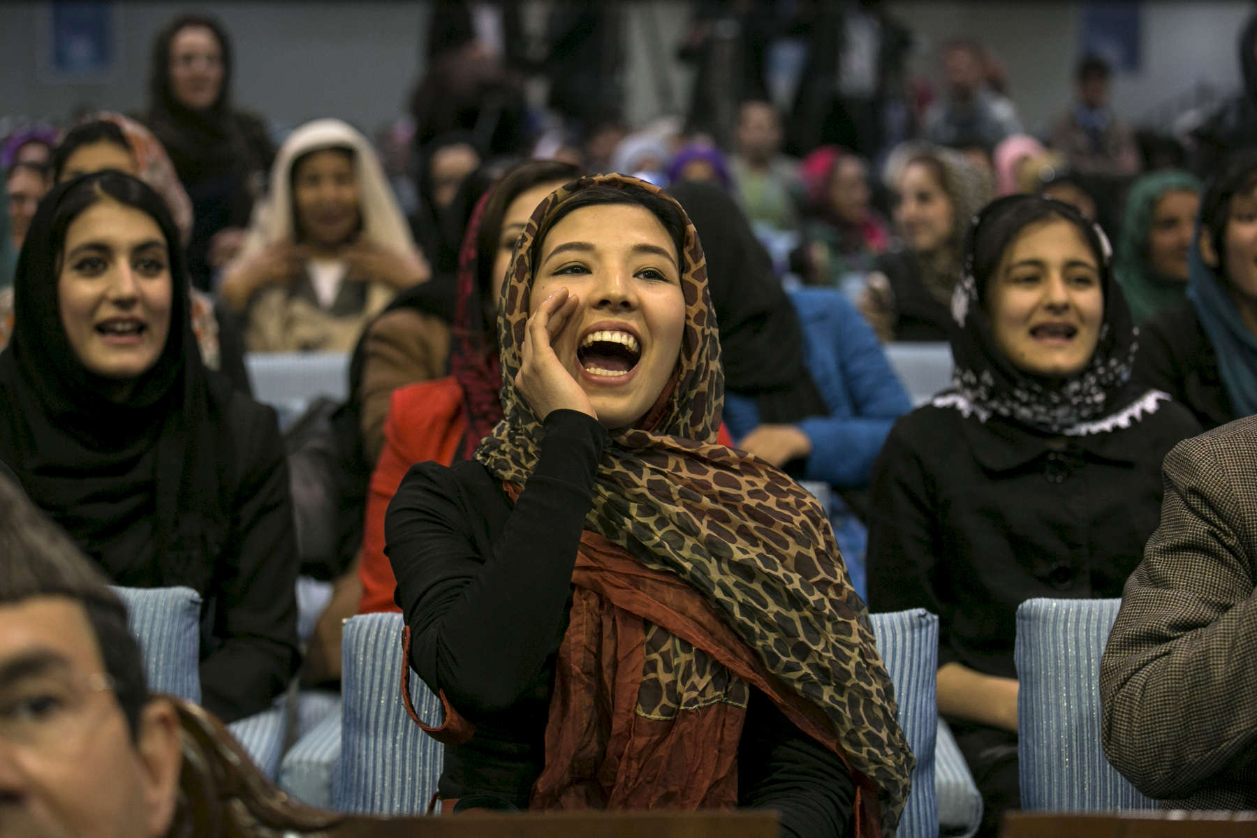 KABUL, AFGHANISTAN -MARCH 31: Afghan women cheer attending an election rally for Afghan vice presidential candidate Habiba Sarabi in Kabul, March 31, 2014. Afghans will go to the polls to vote on April 5th in Afghanistan\'s Presidential election. The election is the third presidential poll since the fall of the Taliban. (Photo by Paula Bronstein/ for the Wall Street Journal)