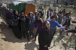 KABUL, AFGHANISTAN - MARCH 22, 2015:  Relatives friends and women\'s rights activists carry the casket of Farkhunda , 27, who was killed by a mob in the center of Kabul and was violently beaten and set on fire onThursday. She was attacked for allegedly burning a copy of the holy Quran which was false. Kabul police have detained nine people related to Farkhnuda's case. President Ashraf Ghani has appointed a delegation to probe the incident. The Imam of Wazir Akbar Khan Mosque was denied permission to take part at Farkhunda's funeral following his remarks on her death.(Photo by Paula Bronstein/ for the Wall Street Journal)