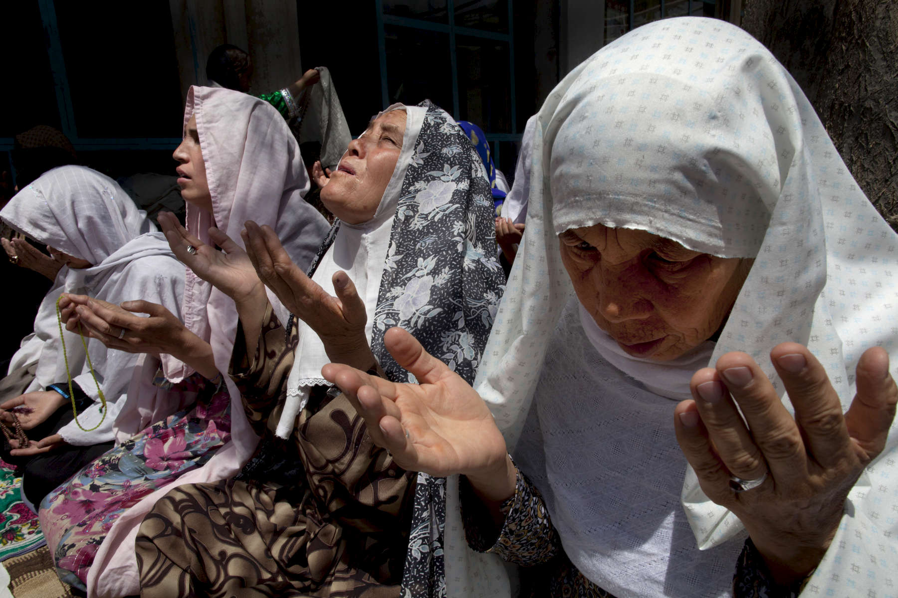 KABUL,  AFGHANISTAN -JUNE 3 : Afghan women pray during friday prayers at the Madinatul-Elm mosque on June 3, 2011 in Kabul, Afghanistan. Afghan women have completely separate sections inside the mosque from the men for prayer however in many parts of the country where violence and the Taliban are a way of life women only pray at home.(Photo by Paula Bronstein /Getty Images)