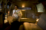 KABUL-AFGHANISTAN-JULY 31: Afghan groom Qais Habibi,19, patiently waits inside a Lincoln limousine for his new bride to finish getting ready at the bridal salon in Kabul July 31, 2007 Afghanistan. Shams Limousine is busy on most days during the busy wedding season renting for 150 USD for 10 hours, shipped from Los Angeles are renting for what he believes is the lowest rate in the world.