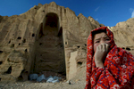 An Afghan girl who lives in the caves of Bamiyan, Afghanistan sits in front of the destroyed Buddha statue in Bamiyan, Afghanistan on February 19,2002. The ancient Buddhist statue was blown up by the Taliban in 2001. Buddha of Bamiyan,  230 km northwest of Kabul at an altitude of 2,500 meters.Paula Bronstein/Getty Images