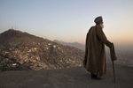 KABUL- AFGHANISTAN: NOV 21: Eid Mohammad, 70 stands on the balcony overlooking the hills of Kabul.  Millions of Afghans live in informal settlements occupied without a formal deed, on land with unclear legal ownership. This lack of a functioning land management system, Afghan and international experts say, looms as one of the most serious obstacles to the country's economic development. Paula Bronstein/ The Wall Street Journal