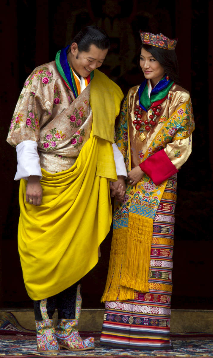 PUNAKHA, BHUTAN - OCTOBER 13: His majesty King Jigme Khesar Namgyel Wangchuck, 31 and the Queen Jetsun Pema, 21, walk out after their marriage ceremony is completed on October 13, 2011 in Punakha, Bhutan. The Dzong is the same venue that hosted the King's historic coronation ceremony in 2008. The Oxford-educated king is popular in the country and the ceremony will be followed by celebration in the capital and countryside.  (Photo by Paula Bronstein/Getty Images)
