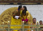 THIMPHU, BHUTAN - OCTOBER 15: The Royal couple King Jigme Khesar Namgyel Wangchuck and Queen of Bhutan Ashi Jetsun Pema Wangchuck kiss in front of thousands of Bhutanese citizens at the celebration ground at ChangLeme Thang on October 15, 2011 in Thimphu, Bhutan. Today marked the third and final day of celebrations for the royal wedding with singing and dancing. (Photo by Paula Bronstein /Getty Images)