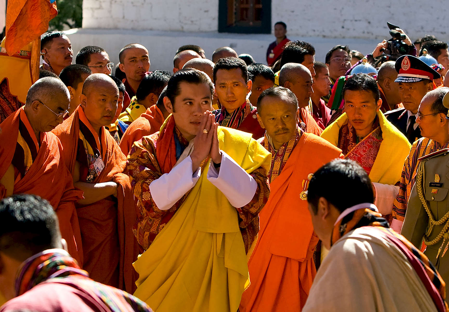 THIMPHU, BHUTAN -NOV 6, 2008: His Majesty Jigme Khesar Namgyel Wangchuck, 28,  arrives at the Dratshang Kuenra Tashichho Dzong November 6, 2008 in Thimphu, Bhutan. The young Bhutanese king, an Oxford-educated bachelor became the youngest reigning monarch on the planet today. He was handed the Raven Crown by his father, the former King Jigme Singye Wangchuck, in an ornate ceremony in Thimpu, the capital. The tiny Himalayan kingdom, a Buddhist nation of 635,000 people is wedged between China and India .  (Photo by Paula Bronstein/Getty Images)