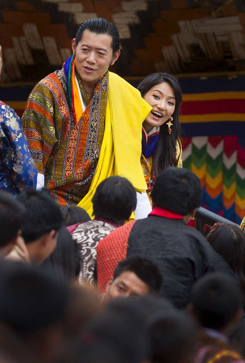 THIMPHU, BHUTAN - OCTOBER 15: The Royal couple, King Jigme Khesar Namgyel Wangchuck, Queen of Bhutan Ashi Jetsun Pema Wangchuck greet thousands of Bhutanese citizens at the celebration ground at ChangLeme Thang October 15, 2011 in Thimphu, Bhutan. In this final day of wedding celebrations for the royal couple more than 50,000 people turned up at the stadium to see dancing and singing.  (Photo by Paula Bronstein /Getty Images)