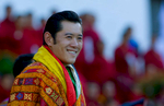 THIMPHU, BHUTAN -NOV 6, 2008: His Majesty Jigme Khesar Namgyel Wangchuck, 28, smiles towards his people at the ceremonial grounds of The  Tendrey Thang November 6, 2008 in Thimphu, Bhutan. The young Bhutanese king, anOxford-educated bachelor became the youngest reigning monarch on the planet today. He was handed the Raven Crown by his father, the former King Jigme Singye Wangchuck, in an ornate ceremony in Thimpu, the capital. The tiny Himalayan kingdom, a Buddhist nation of 635,000 people is wedged between China and India .  (Photo by Paula Bronstein/Getty Images)