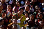 THIMPHU, BHUTAN -NOV 8, 2008: His Majesty Jigme Khesar Namgyel Wangchuck, 28, (center) sits amongst his people in the stands enjoying the games during the Coronation celebration at the Chang-Lime-Thang stadium November 8, 2008 in Thimphu, Bhutan. The young Bhutanese king, an Oxford-educated bachelor became the youngest reigning monarch on the planet when he was crowned on November 6th. The tiny Himalayan kingdom, a Buddhist nation of 635,000 people is wedged between China and India.  (Photo by Paula Bronstein/Getty Images)