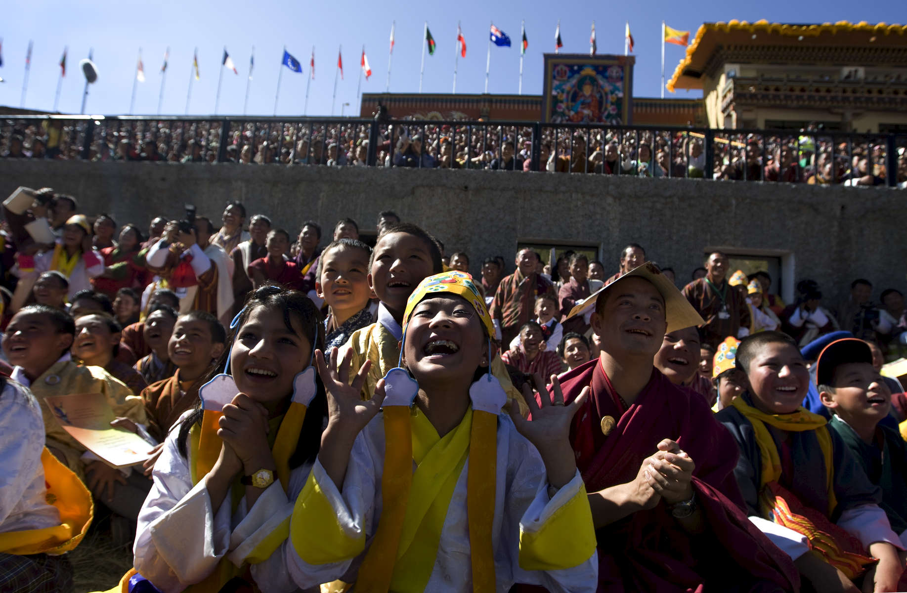 THIMPHU, BHUTAN -NOV 8, 2008: Bhutanese laugh during a game of pillow fighting during the Coronation celebration at the Chang-Lime-Thang stadium November 8, 2008 in Thimphu, Bhutan. His Majesty Jigme Khesar Namgyel Wangchuck, 28, the young Bhutanese king, an Oxford-educated bachelor became the youngest reigning monarch on the planet when he was crowned on November 6th. The tiny Himalayan kingdom, a Buddhist nation of 635,000 people is wedged between China and India.  (Photo by Paula Bronstein/Getty Images)