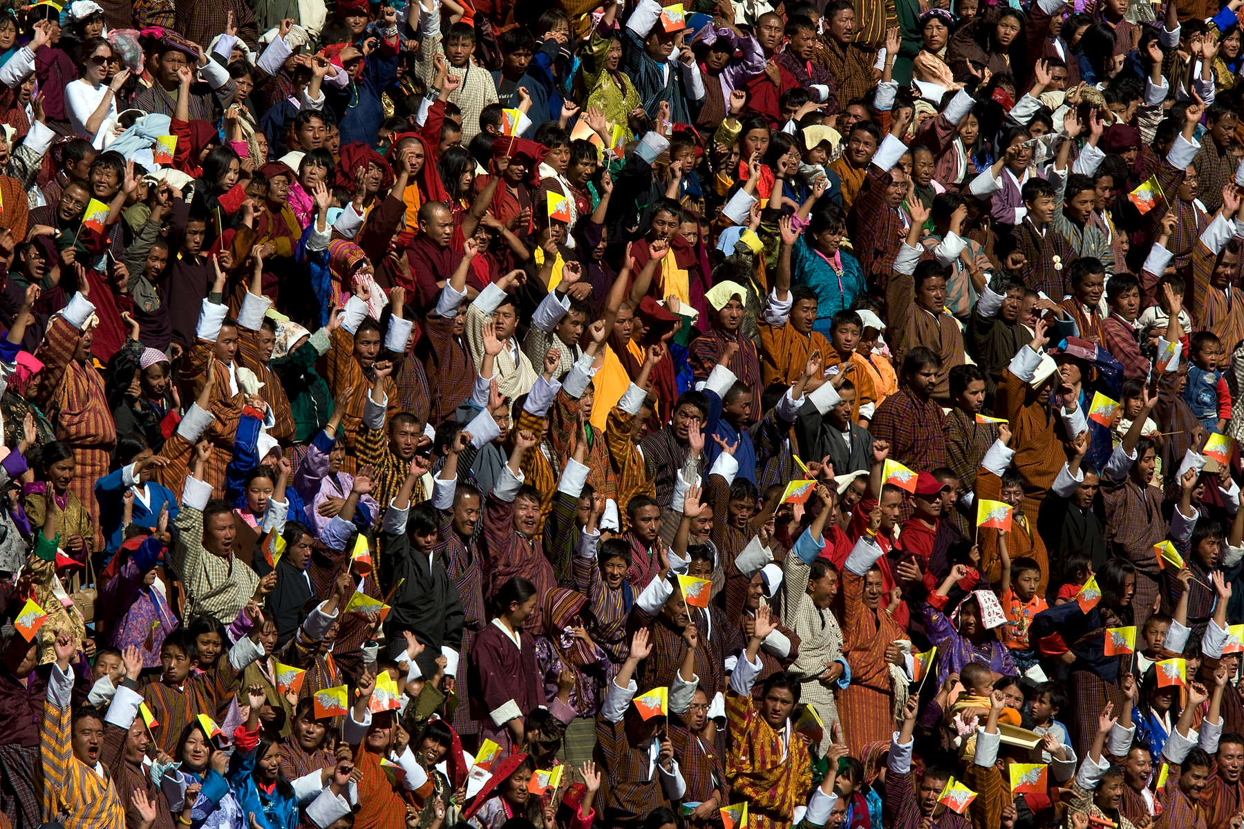 THIMPHU, BHUTAN -NOV 7, 2008: Crowds cheer watchng the cultural program during the Coronation celebration at the Chang-Lime-Thang stadium November 7, 2008 in Thimphu, Bhutan. The young Bhutanese king, an Oxford-educated bachelor became the youngest reigning monarch on the planet when he was crowned yesterday. The tiny Himalayan kingdom, a Buddhist nation of 635,000 people is wedged between China and India.  (Photo by Paula Bronstein/Getty Images)
