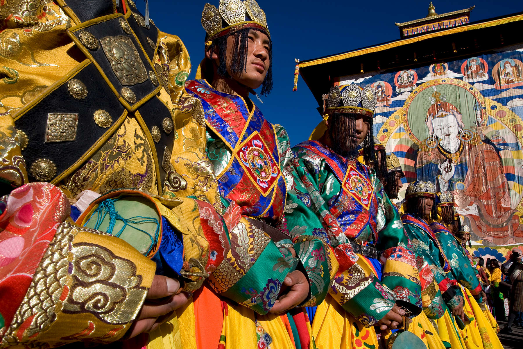 THIMPHU, BHUTAN -NOV 6, 2008: Bhutanese ceremonial dancers stand in line as the coronation ceremony begins November 6, 2008 in Thimphu, Bhutan. Jigme Khesar Namgyel Wangchuck, 28, the young Bhutanese king,  became the youngest reigning monarch on the planet today. He was handed the Raven Crown by his father, the former King Jigme Singye Wangchuck, in an ornate ceremony in Thimpu, the capital. The tiny Himalayan kingdom, a Buddhist nation of 635,000 people is wedged between China and India .  (Photo by Paula Bronstein/Getty Images)
