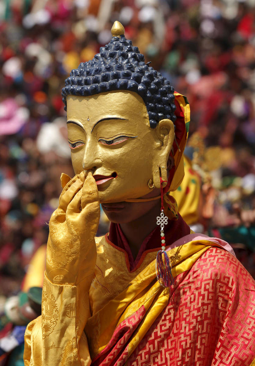 PARO,BHUTAN -MARCH 21, 2008:  A masked Bhutanese dancer performs at the annual Paro Tsechu festival March 21, 2008 in Paro, Bhutan. The festival is a religious one serving as the largest social gathering for the area, celebrating the memory of Guru Padmasambhava depicting key episodes of his life. The Bhutanese tsechu ( religious festival) was established back in the sixteenth century and has become a major tourist attraction in Bhutan. The religious dances are called chhams and are performed by monks as well as lay people. The 5 day festival comes just before Bhutan is set to become the world's newest democracy on the eve of a national election moving Bhutan from a monarchy to a democracy.  (Photo by Paula Bronstein/Getty Images)