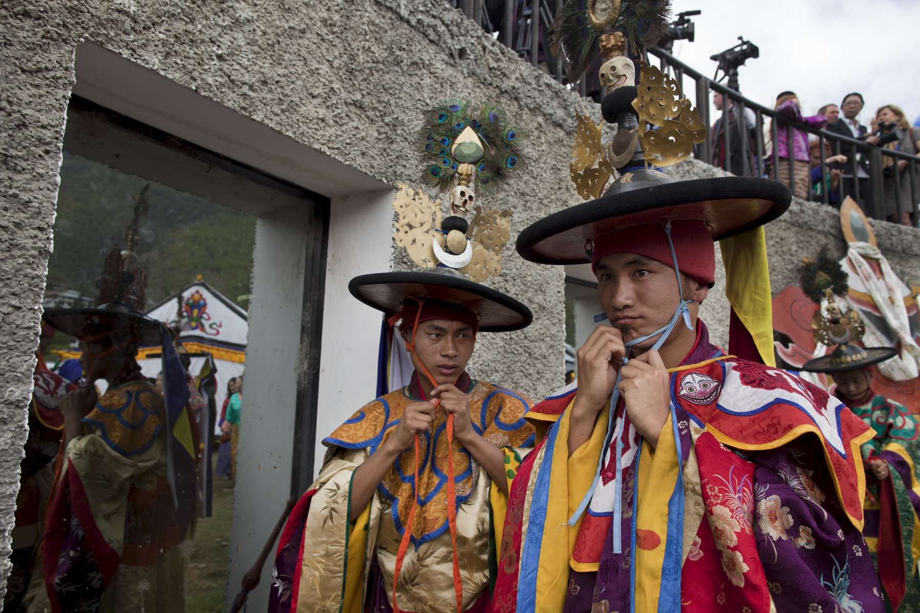 THIMPHU, BHUTAN - OCTOBER 15: Bhutanese monks prepare for the Black Hat dance for the the Royal couple, King Jigme Khesar Namgyel Wangchuck, Queen of Bhutan Ashi Jetsun Pema Wangchuck as part of the royal wedding celebrations at ChangLeme Thang October 15, 2011 in Thimphu, Bhutan. In this final day of wedding celebrations for the royal couple more than 50,000 people turned up at the stadium to see dancing and singing.  (Photo by Paula Bronstein /Getty Images)