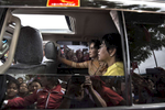 Seik Kaung:  Aung San Suu Kyi is seen in in her vehicle with her aide as supporters surround the car during an early election campaign visit to Shan state.Paula Bronstein for Der Spiegel / Getty Images Reportage