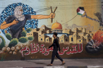 GAZA CITY, GAZA STRIP- MAY 22,2018A man walks by a mural depicting the struggle for freedom May 22,2018 in Gaza city, Gaza strip. The world's largest open air prison along the Israel-Gaza border. Everyone is well aware that Gaza's two million inhabitants are trapped in a cycle of violence and poverty, created by policies and political decisions on both sides. The problems and complications affecting Gaza today are overwhelming. The world, seemingly accustomed to the suffering of the Gazan people turns a blind eye. (Photo by Paula Bronstein )