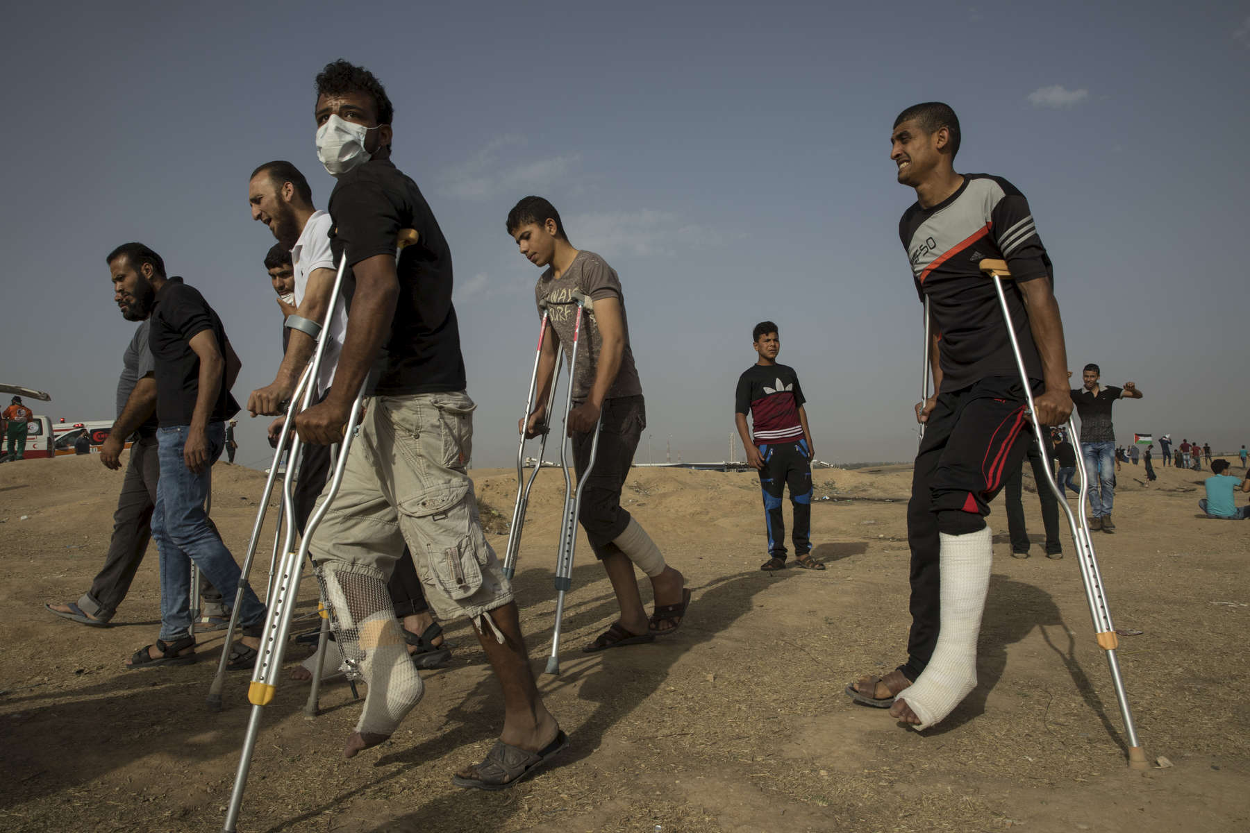 GAZA CITY, GAZA STRIP- MAY 25,2018: Injured protesters are seen at the site near the Israel-Gaza border on May 25,2018 in Gaza city, Gaza strip. At least 110 Palestinians were killed between March 30-May 15th. According to the International Committee of the Red Cross (ICRC), 13,000 Palestinians were wounded (as of June 19, 2018), the majority severely, with some 1,400 struck by three to five bullets. No Israelis were physically harmed during this time period, Israel's use of deadly force was condemned during the UN general assembly on June 13 th along with other human rights organizations. Everyone is well aware that Gaza's two million inhabitants are trapped in a cycle of violence and poverty, created by policies and political decisions on both sides. The problems and complications affecting Gaza today are overwhelming. The world, seemingly accustomed to the suffering of the Gazan people turns a blind eye. (Photo by Paula Bronstein )