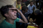 GAZA CITY, GAZA STRIP- MAY 14,2018 A family grieves as another funeral takes place on May 14,2018 in Gaza city, Gaza strip. According to the International Committee of the Red Cross (ICRC), 13,000 Palestinians were wounded (as of June 19, 2018), the majority severely, with some 1,400 struck by three to five bullets. No Israelis were physically harmed during this time period, Israel's use of deadly force was condemned during the UN general assembly on June 13 th along with other human rights organizations.Everyone is well aware that Gaza's two million inhabitants are trapped in a cycle of violence and poverty, created by policies and political decisions on both sides. The problems and complications affecting Gaza today are overwhelming. The world, seemingly accustomed to the suffering of the Gazan people turns a blind eye. (Photo by Paula Bronstein )