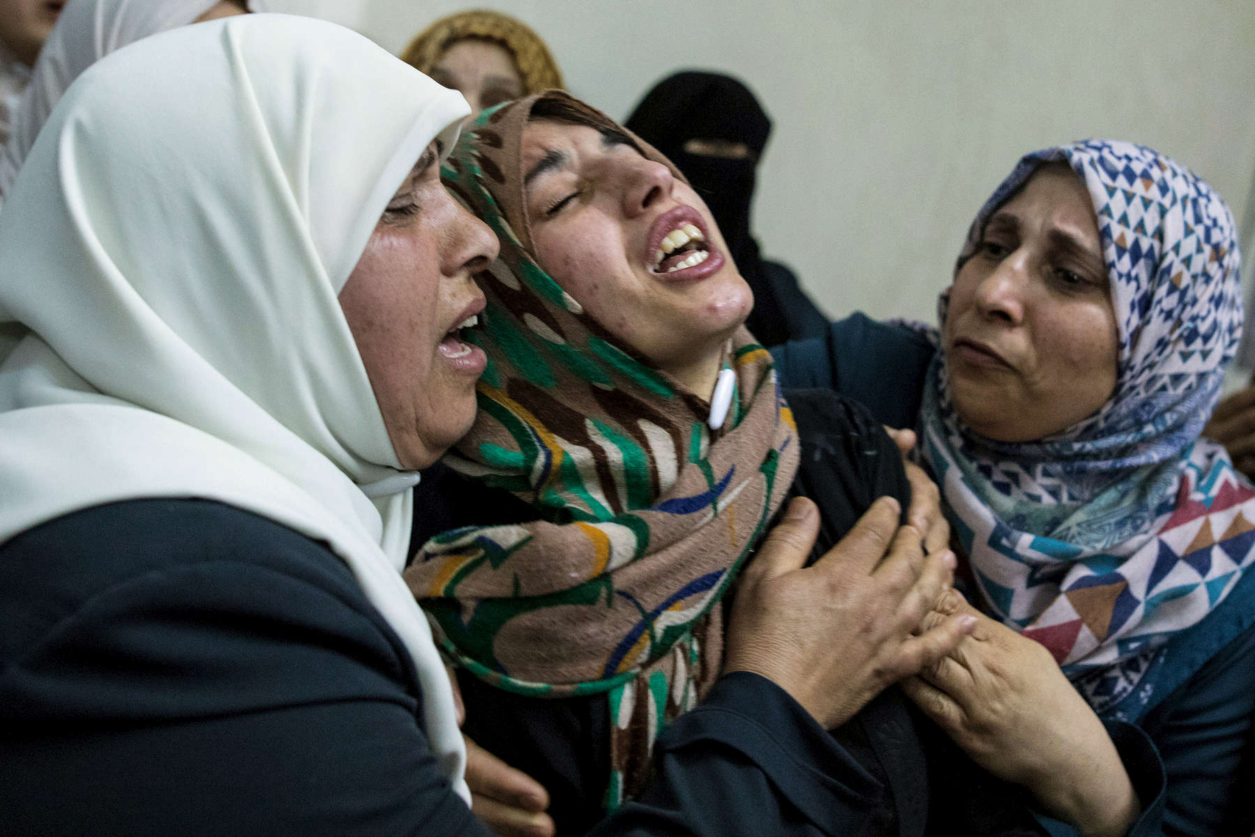 GAZA CITY, GAZA STRIP- MAY 14,2018 A family grieves as another funeral takes place on May 14,2018 in Gaza city, Gaza strip. The world's largest open air prison along the Israel-Gaza border. Everyone is well aware that Gaza's two million inhabitants are trapped in a cycle of violence and poverty, created by policies and political decisions on both sides. The problems and complications affecting Gaza today are overwhelming. The world, seemingly accustomed to the suffering of the Gazan people turns a blind eye. (Photo by Paula Bronstein )