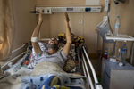 GAZA CITY, GAZA STRIP- MAY 20,2018: A patient prays for his pain to be relieved from his bed at the Al Shifa hospital on May 20, 2018 in Gaza Strip. According to the International Committee of the Red Cross (ICRC), 13,000 Palestinians were wounded (as of June 19, 2018), the majority severely, with some 1,400 struck by three to five bullets. No Israelis were physically harmed during this time period, Israel's use of deadly force was condemned during the UN general assembly on June 13 th along with other human rights organizations.The Israeli military (IDF) started using new weaponry, explosive bullets that shatter bones, tissue, destroying veins and arteries, the aim is to create a handicapped community, especially amongst the young male population. Many of the wounded protesters have to undergo multiple surgeries to try to save their limbs, and in some cases amputation is the only solution. With limited healthcare available in Gaza many were sent to Jordan and Turkey for further treatment. More issues that plague Gaza include a water supply that is 95 percent contaminated and a population forced to live without electricity for 21 hours a day. Gaza is compared to Venezuela with almost half of it's labor force unemployed. Everyone is well aware that Gaza's two million inhabitants are trapped in a cycle of violence and poverty, living in an open air prison. The problems and complications affecting Gaza today are overwhelming. The world, seemingly accustomed to the suffering of the Gazan people turns a blind eye. (Photo by Paula Bronstein )