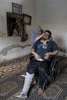 GAZA STRIP- MAY 28,2018 Iyad Mohammed Al-Hourani, 41, shot in behind his knee with an exploding bullet is held by his mother Mai Al-Hourani, 60 on May 28,2018 in the Gaza strip. Iyad is mentally handicapped since birth. He went to the protests by himself wandering up to a bus transporting demonstrators to the protests area without the knowledge of his family.The world's largest open air prison along the Israel-Gaza border. Everyone is well aware that Gaza's two million inhabitants are trapped in a cycle of violence and poverty, created by policies and political decisions on both sides. The problems and complications affecting Gaza today are overwhelming. The world, seemingly accustomed to the suffering of the Gazan people turns a blind eye. (Photo by Paula Bronstein )