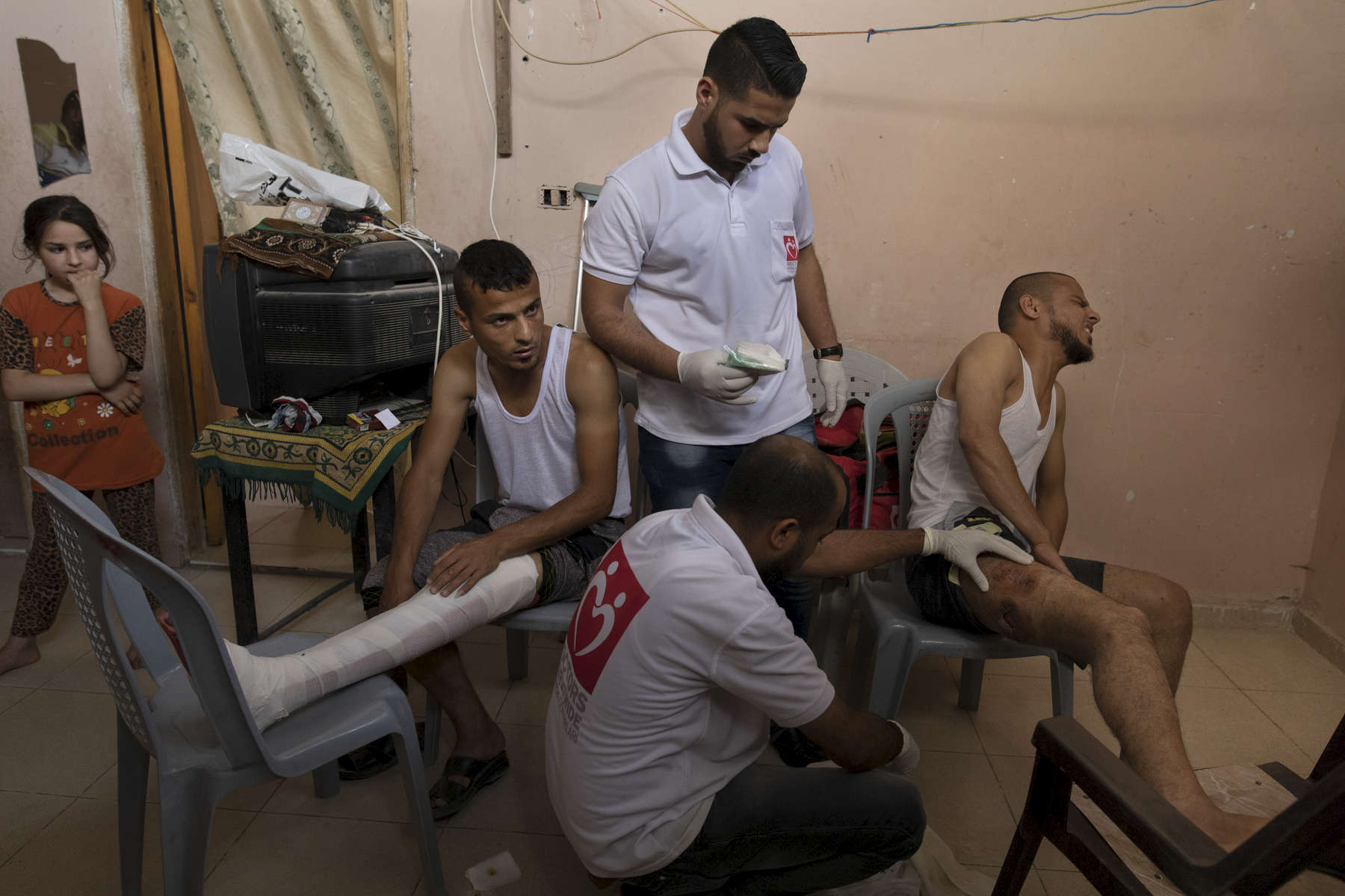 GAZA CITY, GAZA STRIP- MAY 23,2018 Doctors Worldwide,a Turkish ngo gives medical treatment to gunshot victims inside their homes on May 23,2018 in Gaza city, Gaza strip. The world's largest open air prison along the Israel-Gaza border. Everyone is well aware that Gaza's two million inhabitants are trapped in a cycle of violence and poverty, created by policies and political decisions on both sides. The problems and complications affecting Gaza today are overwhelming. The world, seemingly accustomed to the suffering of the Gazan people turns a blind eye. (Photo by Paula Bronstein )