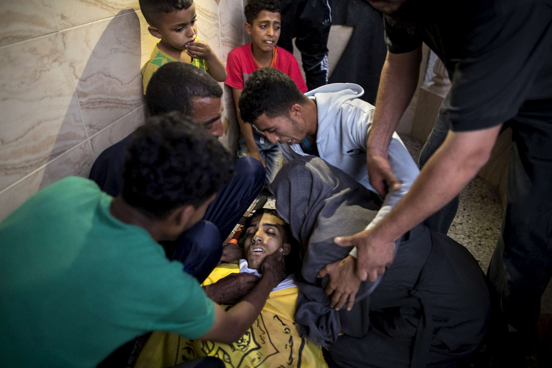 GAZA CITY, GAZA STRIP- MAY 14,2018 A family grieves as another funeral takes place on May 14,2018 in Gaza city, Gaza strip. According to the International Committee of the Red Cross (ICRC), 13,000 Palestinians were wounded (as of June 19, 2018), the majority severely, with some 1,400 struck by three to five bullets. No Israelis were physically harmed during this time period, Israel's use of deadly force was condemned during the UN general assembly on June 13 th along with other human rights organizations.The world's largest open air prison along the Israel-Gaza border. Everyone is well aware that Gaza's two million inhabitants are trapped in a cycle of violence and poverty, created by policies and political decisions on both sides. The problems and complications affecting Gaza today are overwhelming. The world, seemingly accustomed to the suffering of the Gazan people turns a blind eye. (Photo by Paula Bronstein )