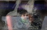 ULAAN BAATAR, MONGOLIA-MARCH 6 : A Mongolian boy looks out from a frosty window on a city bus March 6, 2010  in Ulaan Baatar, Mongolia.  Mongolia is still experiencing one of the worst Winters in 30 years. Presently the government has declared an emergency requiring foreign aid to alleviate the impact of the {quote} Zud{quote} ( Mongolian term for a multiple natural disaster) caused by bitter cold and thick snow. Recently, the UN allocated $3.7 million for humanitarian assistance to Mongolia from its Central Emergency Response Fund (CERF). Currently 1.5 m goats, 921,000 sheep, 169,000 cows and yaks, 89,000 horses and 1,500 camels had died according to the various UN agency reports. (Photo by Paula Bronstein /Getty Images)