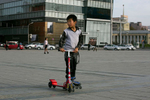 ULAANBATAAR, MONGOLIA - OCTOBER 18: A Mongolian boy on rollerblades hangs out at Sukhbataar Square October 18, 2012 Ulaanbataar, Mongolia. Some 100 years ago, Mongolia gained independence from Qing China, and more than 20 years ago it removed itself from the Soviet Bloc. Since then, the country has been undergoing massive social, economic and political changes. The Oyu Tolgoi, the copper and gold mine is Mongolia's biggest foreign investment project to date adding an estimated 35% value to the country's GDP. Mongolia is a land of amazing contrasts and is the most sparsely populated country on earth with fewer than 3 million people. (Photo by Paula Bronstein/Getty Images)