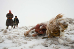 Dealing with another snowstorm, Muukhbayar,50, stands with daughter Javzmaa, age5,  next to their goat that died from starvation in Sergelen, in Tuv province in Mongolia. The family lost  200 of their herd from 500, the family said that many herder nomadic families moved due to the severe cold and snow. Mongolia is still experiencing one of the worst Winters in 30 years with 68 % of the provinces effected. Presently the government has declared an emergency requiring foreign aid to alleviate the impact of the {quote} Zud{quote} ( Mongolian term for a multiple natural disaster) caused by bitter cold and thick snow.