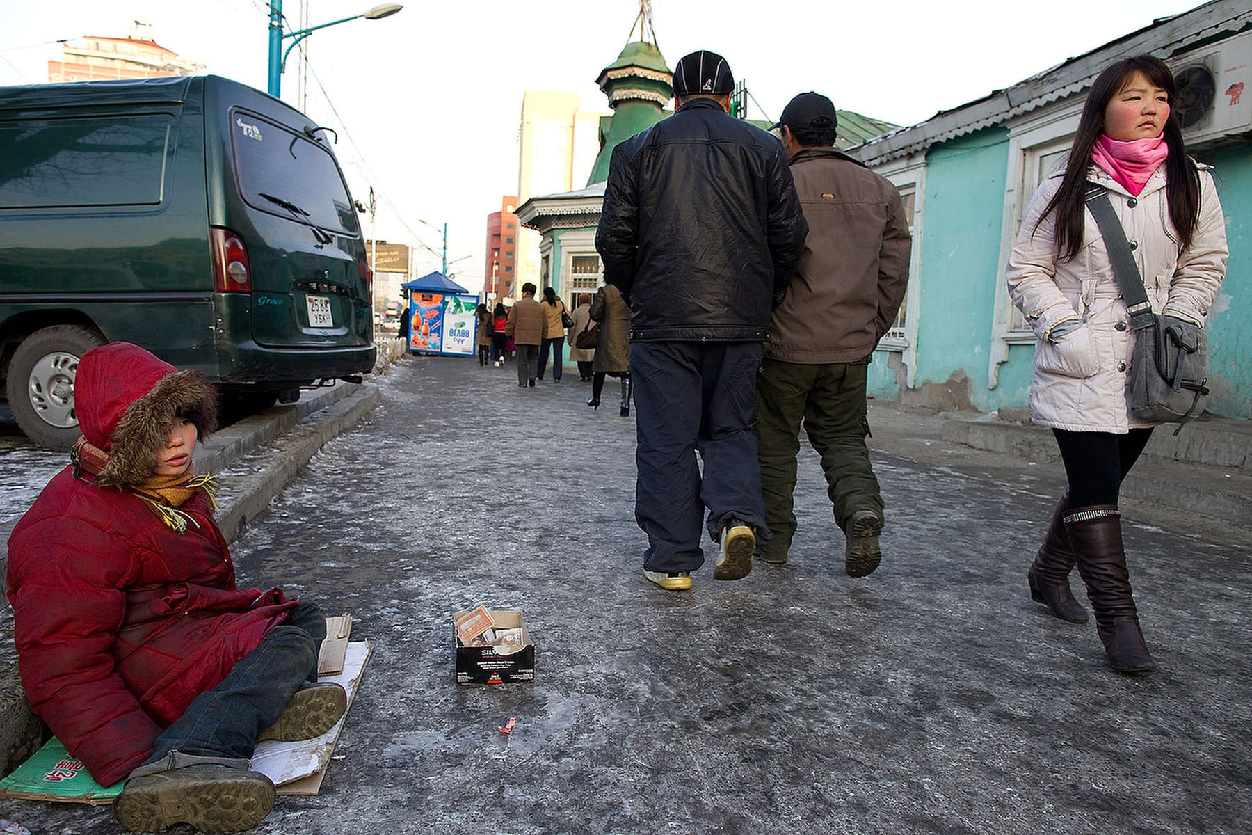 ULAAN BAATAR, MONGOLIA-MARCH 16 :  Otgonjargal, 10, sits on the icy cold street singing to get some quick cash March 16, 2010  in Ulaan Baatar, Mongolia. Otgonjargal spends her time on the streets, not at school. She frequents the Save The Children drop - in center on weekdays and many times runs away with her 2 sisters to stay with other street children. Mongolia suffers with a very high number of alcoholics, all consuming cheap Mongolian vodka that is readily available to the poor and the unemployed, Many Mongolians have immigrated to the capitol city from the far away provinces seeking employment, living in rented traditional circular felt yurts with no running water or electricity. The problem is severe causing the number of street children to rise,  fleeing their abusive, dysfunctional homes. Some children are regularly beaten at home, and for the impoverished it is common to send the child out to make money. During the winter this means extreme hardship, the children out on the city streets are dealing with temperatures dropping as low as -25C mid- Winter. This year Mongolia has experienced the worst winter in 30 years. Presently the government has declared an emergency requiring foreign aid to alleviate the impact of the {quote} Zud{quote} ( Mongolian term for a multiple natural disaster) caused by bitter cold and thick snow that has effected 68% of the provinces. (Photo by Paula Bronstein /Getty Images)