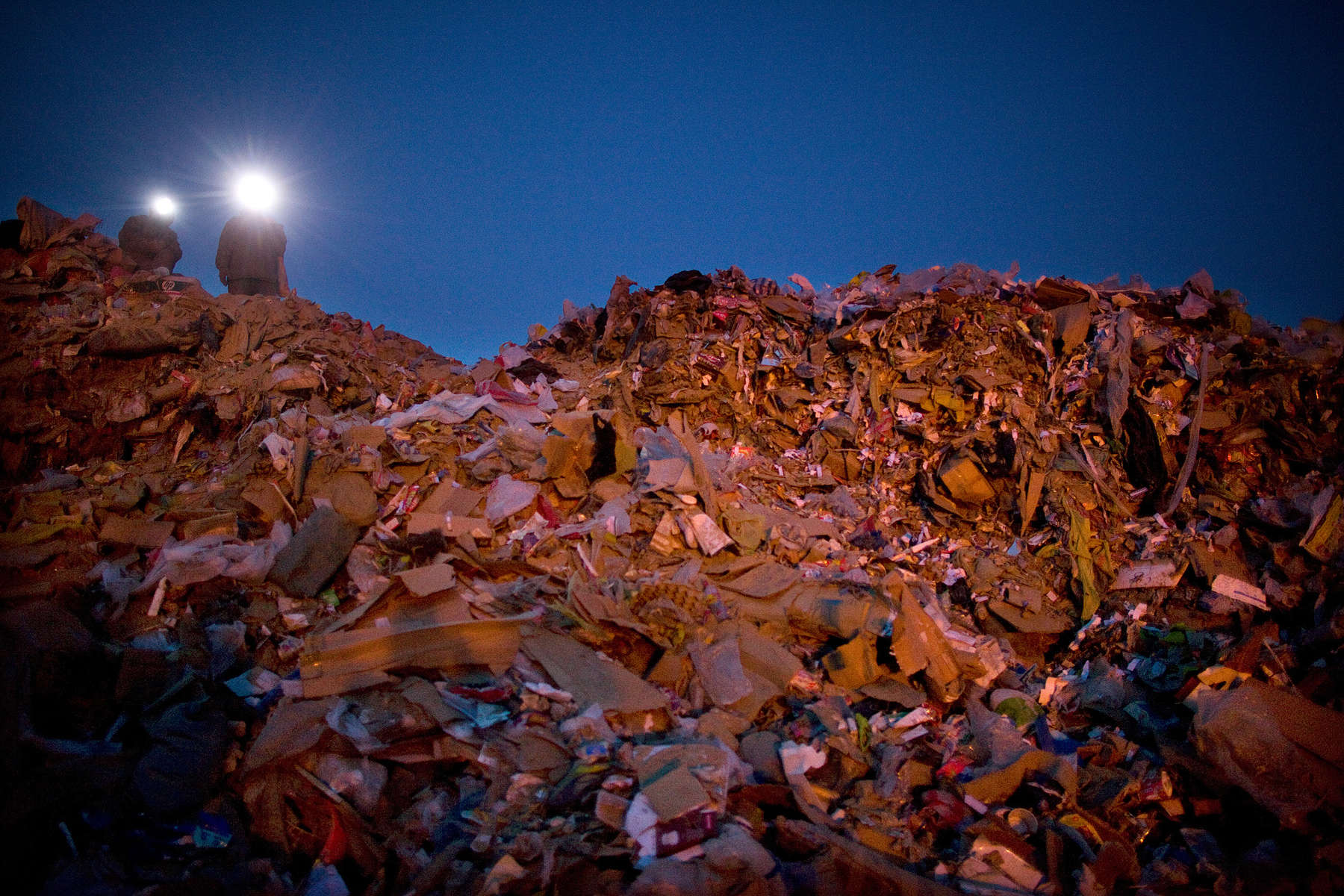ULAAN BAATAR, MONGOLIA-MARCH 5 :  Mongolian men wear head lamps collecting and recycling after sunset at a dump March 5, 2010  in Ulaan Baatar, Mongolia. The average money made per day is $6.50 US. Working at the garbage dump means extreme hardship, long hours outside in frigid temperatures dropping below -25C in the Winter as Mongolia experienced one of the worst Winters in 30 years. Presently the government has declared an emergency requiring foreign aid to alleviate the impact of the {quote} Zud{quote} ( Mongolian term for a multiple natural disaster) caused by bitter cold and thick snow. Currently 1.5 million goats,  921,000 sheep, 169,000 cows and yaks, 89,000 horses and 1,500 camels had died according to the various UN agency reports. Many Mongolians have immigrated to the capitol city from the far away provinces seeking employment, living in rented traditional circular felt yurts with no running water or electricity.(Photo by Paula Bronstein /Getty Images)