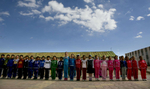 KHANBOGD-SOUTH GOBI DESERT, MONGOLIA - OCTOBER 13:  Students line up during a physical education program at the Khanbogd Secondary school October 13, 2012  in Khanbogd, Mongolia. The population of Khanbogd has doubled in the last few years along with the secondary school adding a new extension to accommodate the growing number of students since Oyu Tolgoi employs most of the people in the town.The Oyu Tolgoi copper and gold mine (translated means Turquiose Hill) is a combined open pit and underground mining project.  While the construction continues open pit mining is currently underway with full production expected later in 2012. When the mine starts full operation the country will be set to become one of the world's top copper and gold producers with estimates of 450,000 tons of copper and 330,000 ounces of gold. Financing for the project has come in part from the Rio Tinto Group and an investment agreement between Ivanhoe Mines and the government of Mongolia. Mongolia's largest foreign investment project to date which is projected to add one-third of future value to the country's GDP. Many estimate Mongolia to be the world's fastest growing economy with an estimated $1.3 trillion in untapped mineral resources. (Photo by Paula Bronstein/Getty Images)
