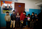ULAAN BAATAR, MONGOLIA-MARCH 11 :  Mongolian street kids wait in line to get registered at the child detention center March 11, 2010  in Ulaan Baatar, Mongolia. The police picked up a dozen boys to get them off the streets in the cold weather housing them at the Ulaan Bataar Child Welfare/ detention center sponsored by World Vision. There about 45 kids live in the dormitory where they get hot food, showers, and some educational activities until their parents claim them. Before the children can go into more permanent shelters they are kept in the welfare center for up to 6 months. After that the state labels them as being abandoned or orphaned. Mongolia suffers with a very high number of alcoholics, all consuming cheap Mongolian vodka that is readily available to the poor and the unemployed, Many Mongolians have immigrated to the capitol city from the far away provinces seeking employment, living in rented traditional circular felt yurts with no running water or electricity. The problem is severe causing the number of street children to rise,  fleeing their abusive, dysfunctional homes. Some children are regularly beaten at home, and for the impoverished it is common to send the child out to make money. During the winter this means extreme hardship, the children out on the city streets are dealing with temperatures dropping as low as -25C mid- Winter. This year Mongolia has experienced the worst winter in 30 years. Presently the government has declared an emergency requiring foreign aid to alleviate the impact of the {quote} Zud{quote} ( Mongolian term for a multiple natural disaster) caused by bitter cold and thick snow that has effected 68% of the provinces. (Photo by Paula Bronstein /Getty Images)
