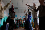 ULAAN BAATAR, MONGOLIA-MARCH 11 :  Mongolian street kids excercise at the child detention center March 11, 2010  in Ulaan Baatar, Mongolia. The police picked up a dozen boys to get them off the streets in the cold weather housing them at the Ulaan Bataar Child Welfare/ detention center sponsored by World Vision. There about 45 kids live in the dormitory where they get hot food, showers, and some educational activities until their parents claim them. Before the children can go into more permanent shelters they are kept in the welfare center for up to 6 months. After that the state labels them as being abandoned or orphaned. Mongolia suffers with a very high number of alcoholics, all consuming cheap Mongolian vodka that is readily available to the poor and the unemployed, Many Mongolians have immigrated to the capitol city from the far away provinces seeking employment, living in rented traditional circular felt yurts with no running water or electricity. The problem is severe causing the number of street children to rise,  fleeing their abusive, dysfunctional homes. Some children are regularly beaten at home, and for the impoverished it is common to send the child out to make money. During the winter this means extreme hardship, the children out on the city streets are dealing with temperatures dropping as low as -25C mid- Winter. This year Mongolia has experienced the worst winter in 30 years. Presently the government has declared an emergency requiring foreign aid to alleviate the impact of the {quote} Zud{quote} ( Mongolian term for a multiple natural disaster) caused by bitter cold and thick snow that has effected 68% of the provinces. (Photo by Paula Bronstein /Getty Images)