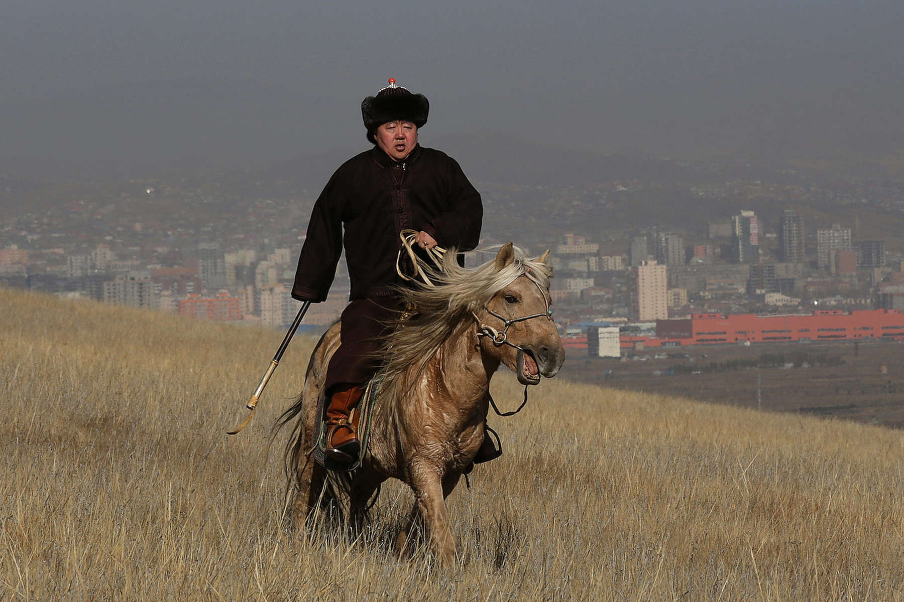 ULAANBATAAR, MONGOLIA - OCTOBER 26: President Tsakhiagiin Elbegdorj rides his horse along the grounds of the presidential residence October 26, 2012 in Ulaanbataar, Mongolia. President Tsakhiagiin Elbegdorj was elected  on May 25, 2009, he had previously served two terms as Prime Minister and held the positions of Deputy Speaker and Majority Leader in Parliament. The first lady, Bolormaa Khajidsuren is a mother of 4 children, and the extended Presidential family includes 20 foster children coming from a variety of government children's homes. Some 100 years ago, Mongolia gained independence from Qing China, and more than 20 years ago it removed itself from the Soviet Bloc. Since then, the country has been undergoing massive social, economic and political changes. The Oyu Tolgoi copper and gold mine is Mongolia's biggest foreign investment project to date adding an estimated 35% value to the country's GDP. Mongolia is a land of amazing contrasts and is the most sparsely populated country on earth with fewer than 3 million people. (Photo by Paula Bronstein/Getty Images)