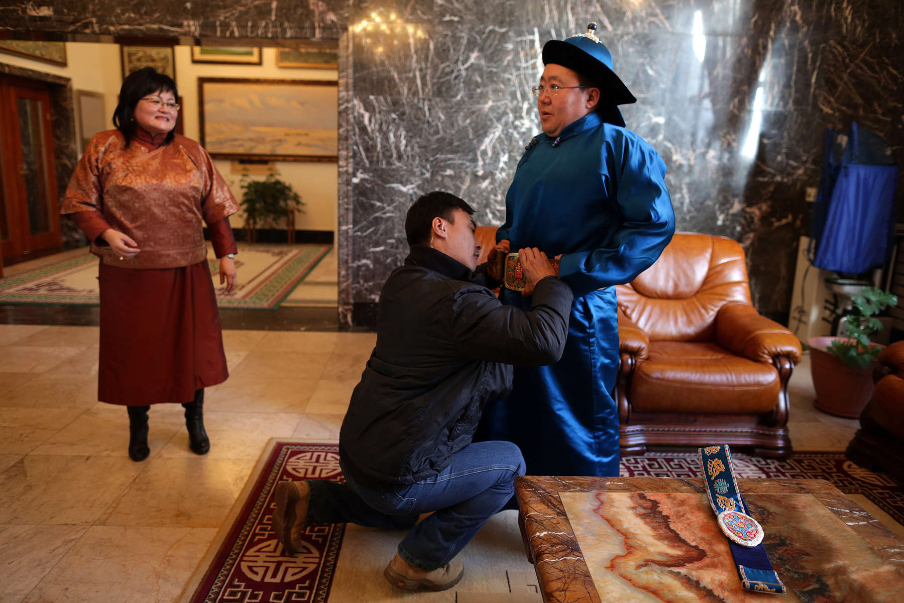 ULAANBATAAR, MONGOLIA - OCTOBER 26: The first lady, Bolormaa Khajidsuren watches her husband President Tsakhiagiin Elbegdorj  get dressed to go horsebackriding on the estate October 26, 2012 in Ulaanbataar, Mongolia. President Tsakhiagiin Elbegdorj was elected  on May 25, 2009, he had previously served two terms as PrimeMinister and held the positions of Deputy Speaker and Majority Leader in Parliament. The first lady, Bolormaa Khajidsuren is a mother of 4 children, and the extended Presidential family includes 20 foster children coming from a variety of government children's homes. Some 100 years ago, Mongolia gained independence from Qing China, and more than 20 years ago it removed itself from the Soviet Bloc. Since then, the country has been undergoing massive social, economic and political changes. The Oyu Tolgoi copper and gold mine is Mongolia's biggest foreign investment project to date adding an estimated 35% value to the country's GDP. Mongolia is a land of amazing contrasts and is the most sparsely populated country on earth with fewer than 3 million people. (Photo by Paula Bronstein/Getty Images)