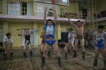 Mongolian wrestlers jump during warm up exercises at a local wrestling school in Ulan Batar. Mongolia is the most sparsely populated country on earth, but its people are some of the strongest. In Mongolia, wrestling is the most important sport that runs deep into its culture along with horsemanship and archery. Going back for hundreds of years, history books tell the story of how Genghis Khan considered wrestling to be an important way to keep his army combat ready while back in the Qing Dynasty (1646–1911) regular wrestling events were held. In Mongolia's capitol city, Ulan Batar is home to many wrestling schools where almost daily you can see dozens of young men sweating in crowded gyms while in schools both girls and boys are taught some wrestling techniques.While my photo story gives a real behind the scenes look, it is unusual for a woman to document this macho scene of sweat and endurance.
