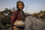CHAUTARA, NEPAL -MAY 3, 2015:. A woman stands on a cracked road near the badly effected village of Chautara in the badly effected Sindhupalchok province  So far more than 7,000 people have died in Nepal\'s worst earthquake in 80 years.  (Photo by Paula Bronstein/ for the Wall Street Journal)