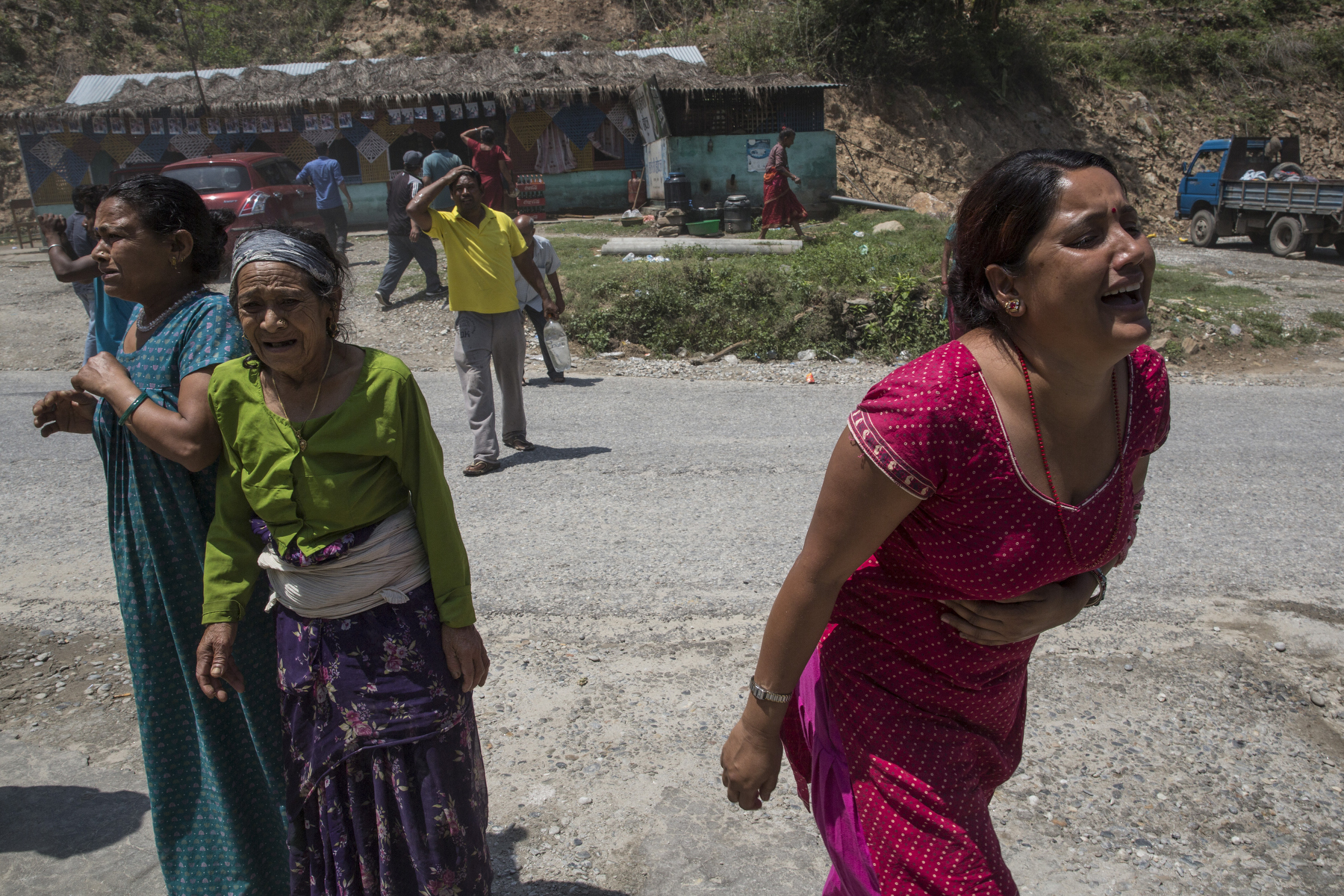 Sindhupalchok District , Nepal -May 12, 2015: People scream as the 7.3 earthquakes hits the Tatopani area causing numerous landslides. Photo by Paula Bronstein for IFRC ( International Federation of Red Cross) Wall Street Journal)