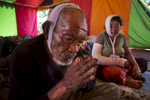 CHAUTARA, NEPAL -MAY 3, 2015:. Budhi Tamang  prays inside a tent for injured quake victims in the badly effected village of Chautara in the badly effected Sindhupalchok province  So far more than 7,000 people have died in Nepal\'s worst earthquake in 80 years.  (Photo by Paula Bronstein/ for the Wall Street Journal)