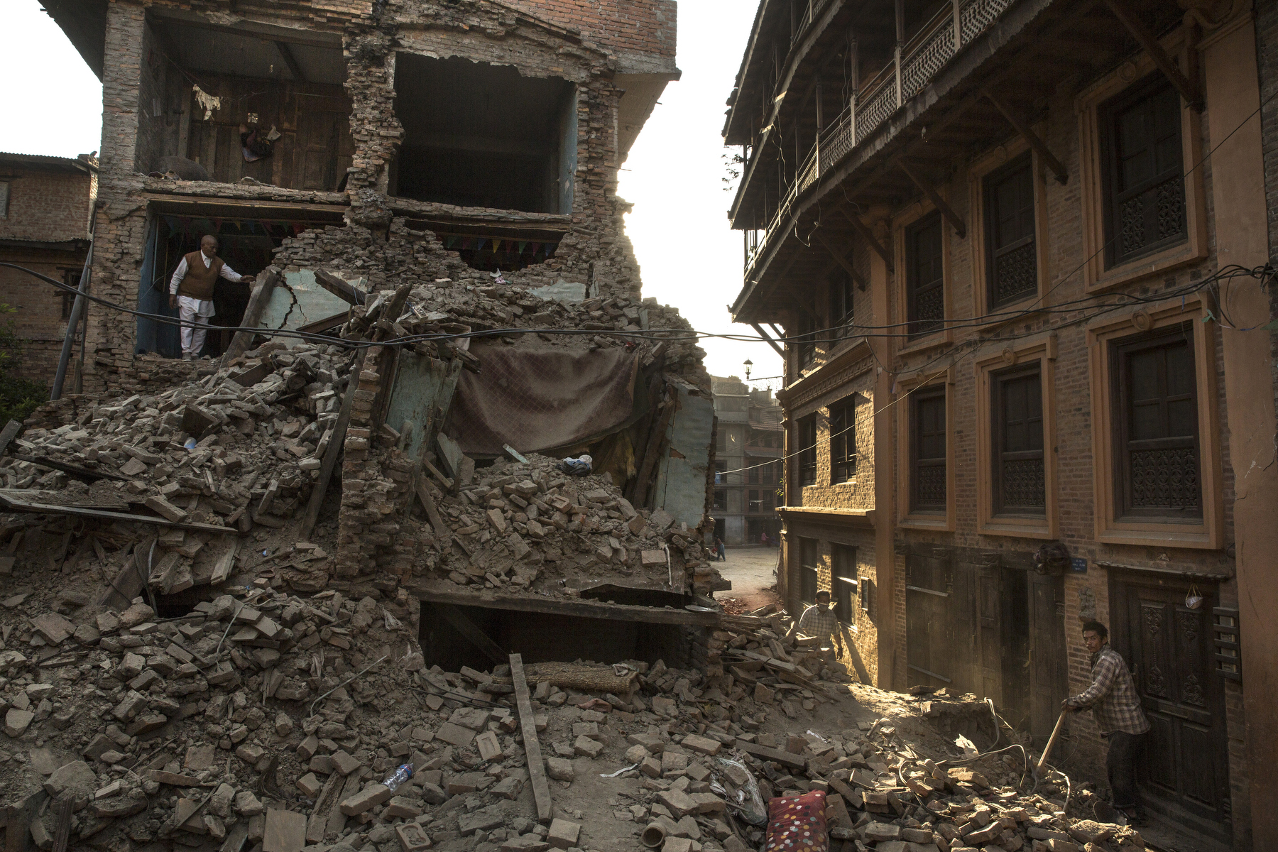 BHAKTAPUR, NEPAL -MAY 5, 2015: A man stands in the rubble of his home in Bhaktapur where most of the old city has been flattened. So far more than 7,000 people have died in Nepal\'s worst earthquake in 80 years.  (Photo by Paula Bronstein/ for the Wall Street Journal)