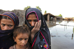SANGI PATAN, PAKISTAN-AUG 11 : Pakistani flood victims get evacuated by the Pakistan Navy on a boat rescue mission as flood waters continue to rise August 11, 2010 in Sangi Patan, Pakistan.  The country\'s agricultural heartland has been hit hard as rice, corn and wheat fields are flooded creating a massive lake that goes on for many miles. Pakistan is suffering from the worst flooding in 80 years as the army and aid organizations struggle to cope with the scope of the wide spread scale of the disaster which has killed atleast 1,600 people and displaced millions. In addition, Pakistani\'s have become more frustrated with the government\'s response and a lack of foreign aid. The U.N has described the disaster as unprecedented. (Photo by Paula Bronstein/ Getty Images)